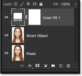The Layers panel showing the Solid Color fill layer above the two image layers. Image © 2016 Steve Patterson, Photoshop Essentials.com