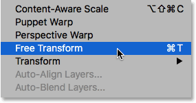 Selecting the Free Transform command from under the Edit menu in Photoshop. Image © 2016 Steve Patterson, Photoshop Essentials.com