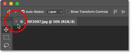 To close a Photoshop document, click the 'x' icon in the tab.