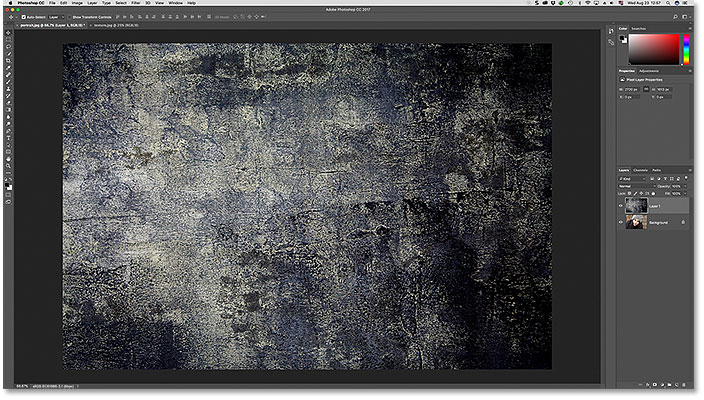 The texture image has been pasted into the portrait photo's document in Photoshop.