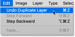 Choosing the Undo Duplicate Layer command in Photoshop.