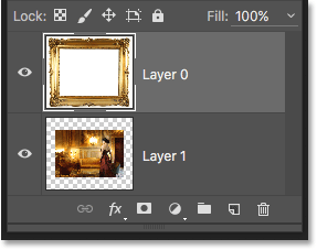 Layer 0 has been moved above Layer 1 in the Layers panel. Image © 2016 Photoshop Essentials.com