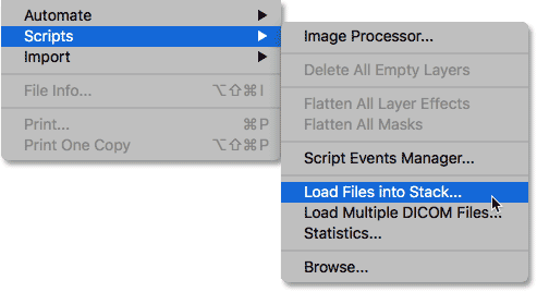 Selecting the Load Files into Stack command from under the File menu. Image © 2017 Photoshop Essentials.com