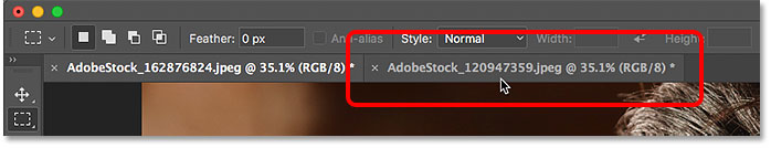 Clicking the document tabs to switch between open images in Photoshop