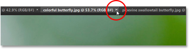 Closing a tabbed document in Photoshop CS6. Image © 2013 Photoshop Essentials.com