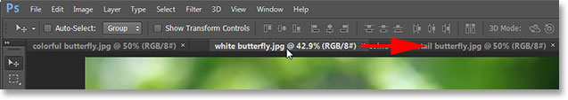 Dragging a tab to the right to change the order of the images. Image © 2013 Photoshop Essentials.com
