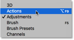 Selecting the Actions panel from under the Window menu. Image © 2016 Photoshop Essentials.com
