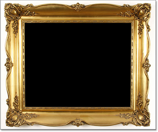 The area inside the photo frame has been filled with black. Image © 2016 Photoshop Essentials.com