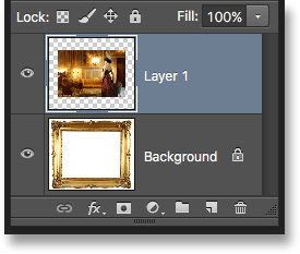 The Layers panel showing the photo added above the Background layer. Image © 2016 Photoshop Essentials.com