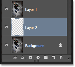 Creating a new layer below the selected layer. Image © 2016 Photoshop Essentials.com.