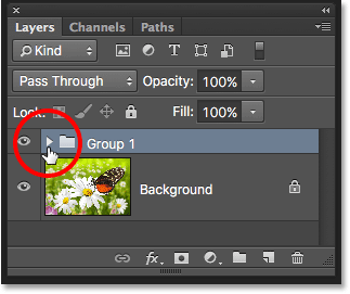 A new layer group named Group 1 appears in the Layers panel. Image © 2016 Photoshop Essentials.com