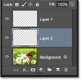 Layer 2 has been moved below Layer 1 in the Layers panel. Image © 2016 Photoshop Essentials.com