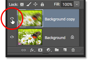 The layer visibility icon in the Layers panel in Photoshop. Image © 2016 Photoshop Essentials.com