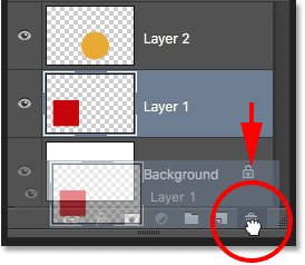 Dragging Layer 1 into the Trash Bin in the Layers panel. Image © 2016 Photoshop Essentials.com