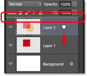 Dragging Layer 1 above Layer 2 in the Layers panel. Image © 2016 Photoshop Essentials.com