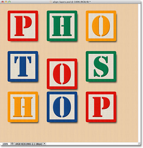 The block in the middle center becomes visible in the document. Image © 2011 Photoshop Essentials.com