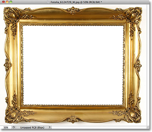 Selecting the inside of the frame with the Magic Wand Tool. Image © 2011 Photoshop Essentials.com