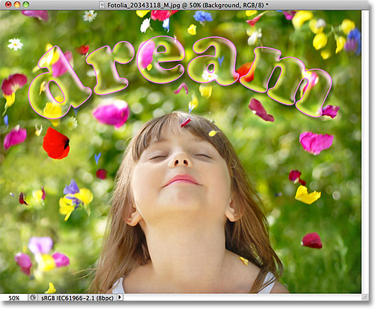 The text is now 100% transparent while the layer styles remain 100% visible. Image © 2011 Photoshop Essentials.com