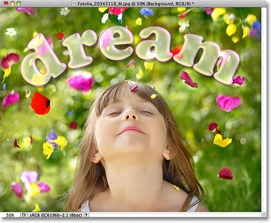 The text is now 50% transparent but the layer styles remain 100% opaque. Image © 2011 Photoshop Essentials.com