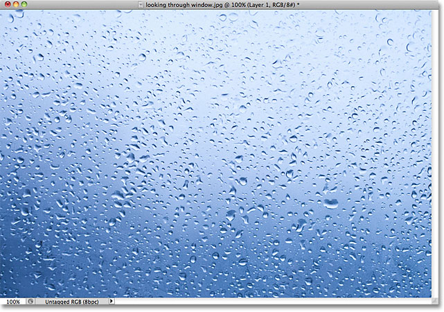 The photo was moved to the new document and placed in the center. Image © 2011 Photoshop Essentials.com