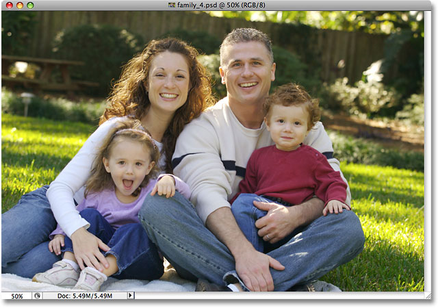 A photo of a family open in Photoshop. Image licensed from iStockphoto by Photoshop Essentials.com.