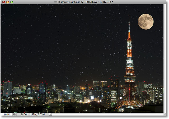 A photo of a moon over the city at night. Image © 2009 Photoshop Essentials.com