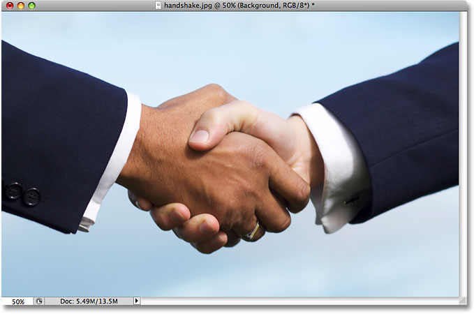 Two business people shaking hands. Image licensed by iStockphoto by Photoshop Essentials.com