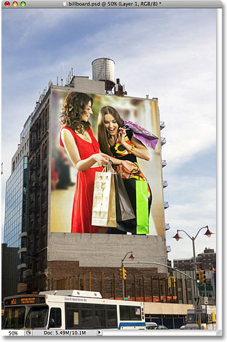 The photo of two women shopping now appears on the billboard. Image © 2009 Photoshop Essentials.com