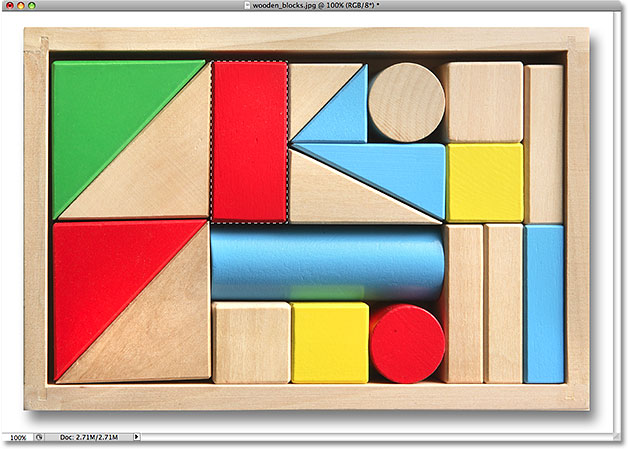 The wooden block is now selected. Image © 2009 Photoshop Essentials.com