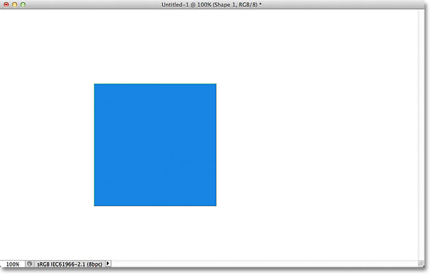 The blue shape re-appears after turning the vector mask back on. Image © 2011 Photoshop Essentials.com
