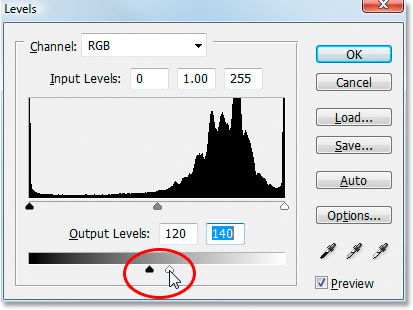 Dragging the Output sliders in towards the center in Photoshop's Levels adjustment dialog box.