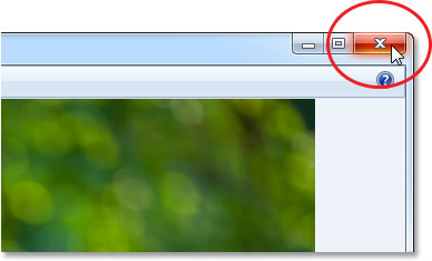 Clicking the Close icon in the top right of Windows Photo Viewer. Image © 2013 Photoshop Essentials.com