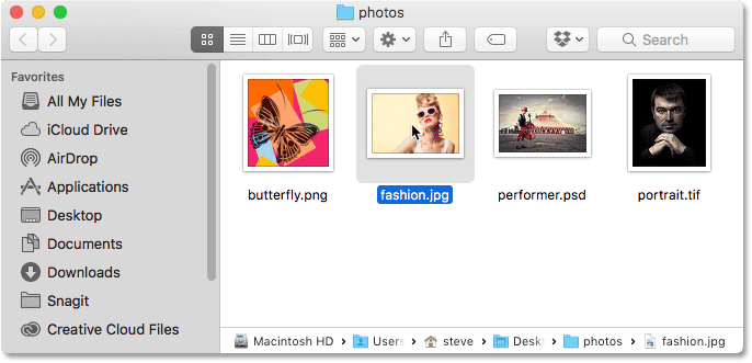 Opening of of the photos in the Finder window. Image © 2016 Photoshop Essentials.com