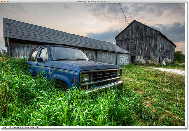 An HDR photo of an old truck in tall grass in front of a weathered barn. Image © 2012 Steve Patterson