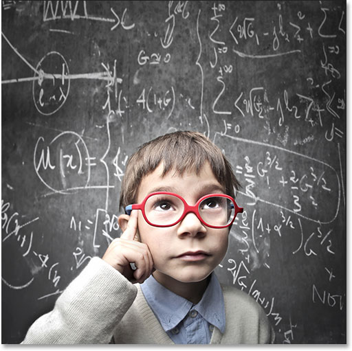 Thinking child with a blackboard in the background. Image licensed from Shutterstock by Photoshop Essentials.com