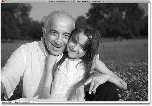 The skin tones now appear lighter in the black and white version. Image © 2009 Photoshop Essentials.com.