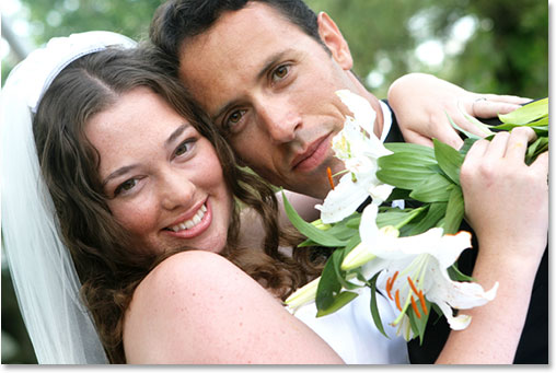A smiling bride and groom. Image licensed from iStockphoto by Photoshop Essentials.com