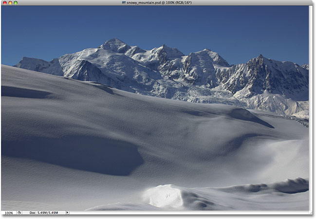 Snow covered mountains photo. Image licensed from iStockphoto by Photoshop Essentials.com.
