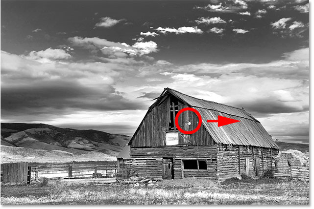 Clicking on the barn and dragging to the right to lighten it. Image © 2017 Photoshop Essentials.com