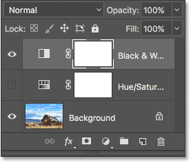 The Layers panel showing the Black & White adjustment layer above the image. Image © 2017 Photoshop Essentials.com