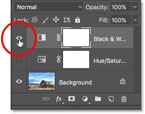 Turning off the Black & White adjustment layer. Image © 2017 Photoshop Essentials.com