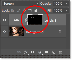 The layer mask thumbnail shows us where we've painted with white. Image © 2017 Photoshop Essentials.com