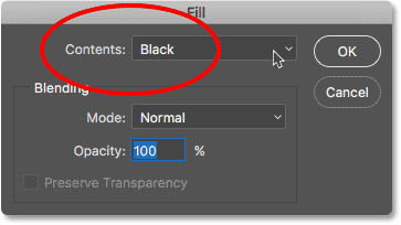 Changing the Contents option to Black in the Fill dialog box. Image © 2017 Photoshop Essentials.com