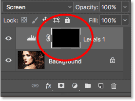 The layer mask thumbnail for the adjustment layer is now filled with black. Image © 2017 Photoshop Essentials.com