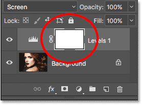 The Layers panel showing the white layer mask thumbnail. Image © 2017 Photoshop Essentials.com