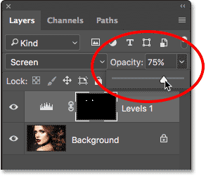 Lowering the opacity of the Levels adjustment layer. Image © 2017 Photoshop Essentials.com