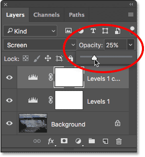 Lowering the opacity value of the Levels adjustment layer. Image © 2017 Photoshop Essentials.com