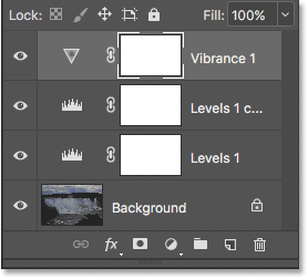 The Layers panel showing the new Vibrance adjustment layer. Image © 2017 Photoshop Essentials.com