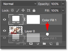 Dragging the Solid Color fill layer below Layer 0. Image © 2016 Photoshop Essentials.com