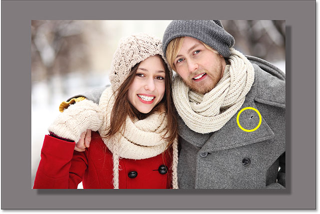 Clicking on the man's jacket changes the color of the border to gray. Image © 2016 Photoshop Essentials.com